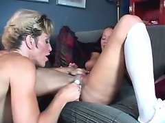 Two busty lezzies play with dildo