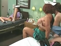 Lesbo nurses lick each other and masturbate in bed