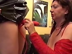Busty granny lesbian in red sucks huge strapon